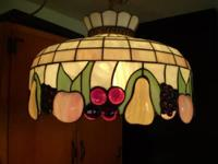This Tiffany Style Fruit colored glass hanging light is