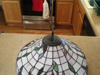 This Tiffany Style Hanging Lamp is 18 inches in