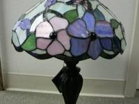 Table lamp done in the style of Tiffany's. See the