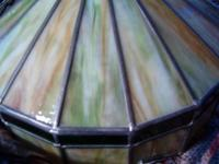 This is a genuine leaded shade in swirled greens with