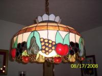 Beautiful stained glass with designs of apples and