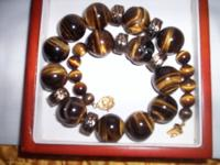 I AM SELLING THIS BEAUTIFUL TIGER EYE BEAD NECKLACE.