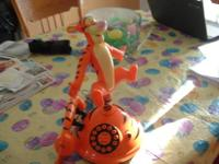 This is a working Tigger Telephone that sings the