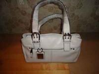 Very cute Tignanello White Leather Hand Bag. There are