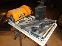 Great performing wet saw for cutting tile. I finished