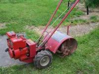 TROY BUILT TILLER 5HP IN GREAT CONDITION. IF INTERESTED