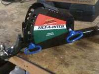 A multiposition, load leveling trailer hitch that when