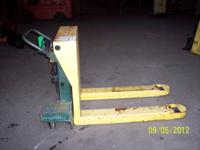 3 tilt back pallet jacks,2 are battery operated and one