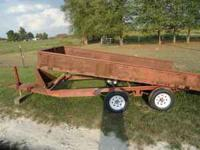 ALL METAL DIAMOND PLATE TILT TRAILER. NEW TIRES AND