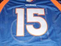 I have a Tebow XL Size 52 Blue jersey for sale NWT