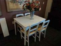 white wooden table with 4 chairs $150 wrought iron