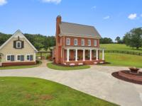 Situated on the most beautiful gated 18+ acre estate is