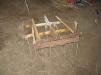 This is a home made flexible tine harrow made to pull