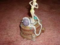 "Hello this is a tinkerbell music box. It plays ""You can"