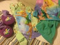 Lot includes  2 sets of Tinkerbell pajamas  dark green