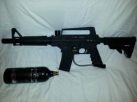 Tipmann Alpha Black paintball gun. Comes with 20oz Pure