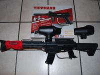 Up for sell is a Tippmann A5 Paintball gun with MilSim