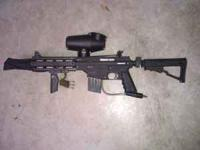 I got a Tippmann project salvo paintball gun. It is