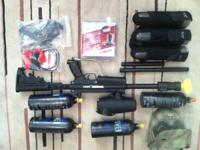 Tippmann A5 paintball marker with mods and gear.