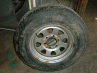 P 255 65 16 mounted on a 6 lug rim. Tire has about 80%
