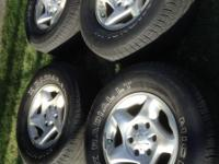 Four factory alloy rims with tires size