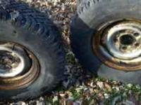 2 studded snow tires 235 -75 -r15. On ford 5 bolt steel