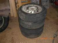 "Four ""Dean Galaxie GT"" tires on rims. Rims are 4 bolt."