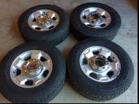Set of four aluminum wheels and tire tires off of a