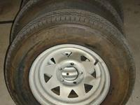 Set of 4 boat trailer tires mounted on galvanized