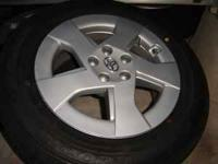 FOUR BRAND NEW TOYOTA PRIUS TIRES, RIMS, AND HUBCABS -