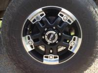 I have 4 Toyo a/t 285/75/17 and rim I will trade for