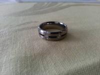 Titanium band with black stripe around the middle and