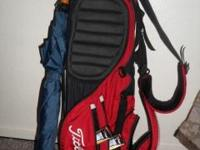 FOR SALE IS A USED LIGHTWEIGHT RED/BLACK TITLEIST STAND