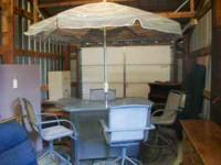 Like new patio bar 4 swivel bar stools & umbrella.