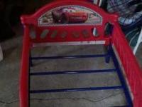 Cars toddler bed. In good shape 55 inches long... any