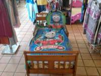 Very nice caramel colored wood toddler bed. Can be seen