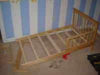 Excellent condition, light wood toddler bed with