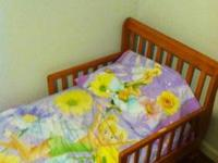 Used Wooden Toddler bed. Comes with ? toddler serta