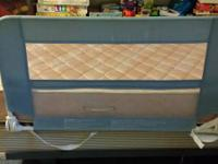 Light blue and white (mesh part) toddler bed rail with
