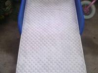 Blue toddler bed with mattress both in really good