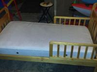 Toddler bed with mattress. Only used for a short time.