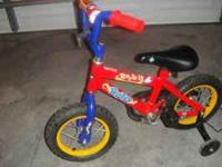 Toddler bike with training wheels, needs some air.