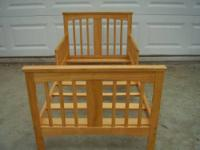 This is a solid wood toddler bed. Made in America. Buy