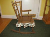 Here is a charming little rocking chair for a toddler.
