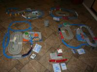 6 Tomica Train Sets including instructions.  All pieces