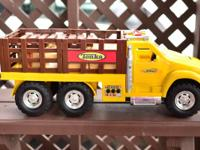 My kid is offering his two Tonka trucks which include a