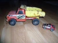 appears to be an original Tonka truck & car truck in