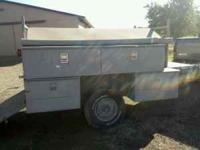 Tool trailer with lumber rack and ramp. Needs paint and