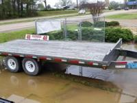 This is a heavy duty flat bed trailer and the deck is