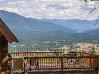 On top of the world views from this charming log home